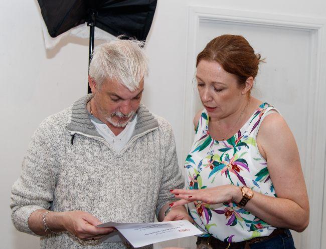 man and woman looking at paperwork