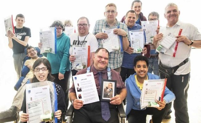 group holding up certificates