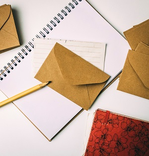 Writing paper and envelopes, a notepad and a pencil