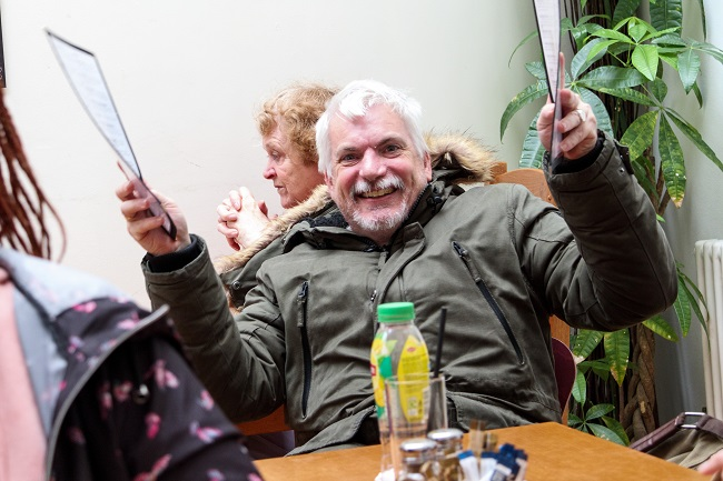 A happy looking man in a cafe
