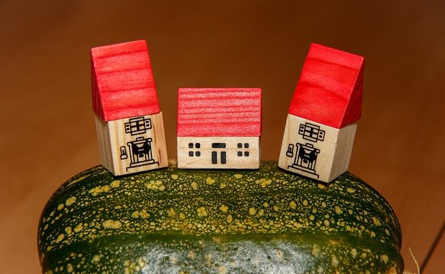 Three small wooden houses